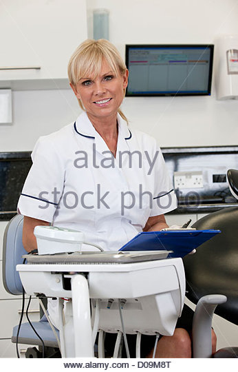 A female dentist in a dental surgery - Stock Image