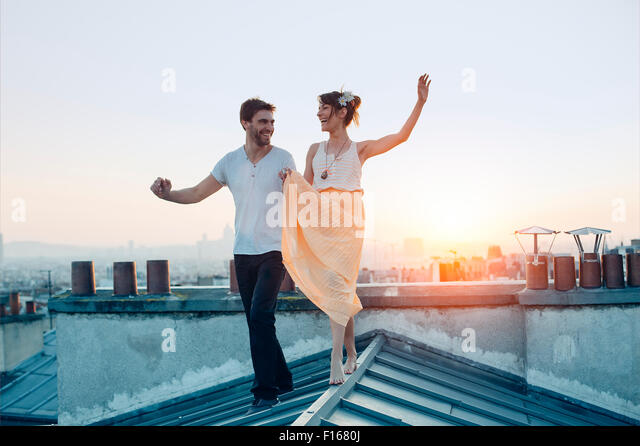 Paris, Couple walking on paris's roofs - Stock Image