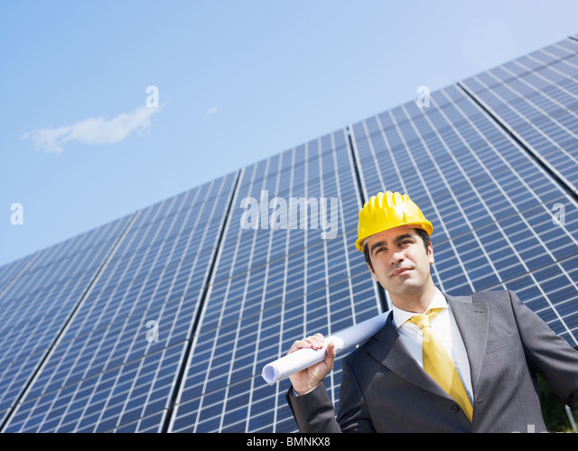 male engineer near solar panels - Stock Image