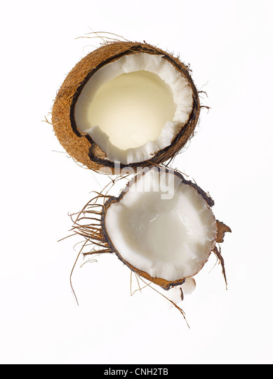 fresh raw coconut shell cut open - Stock Image
