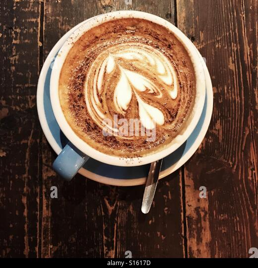 Cappuccino from above, in British coffee shop - Stock-Bilder