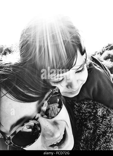 Close-Up Of A Woman With Her Daughter Outdoors - Stock Image