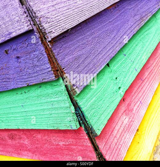 Multi coloured wooden shed - Stock Image