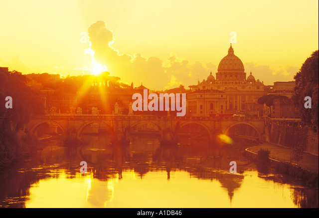 Italy Rome St Peter's Basilica reflecting in the Tiber River at sunset - Stock Image