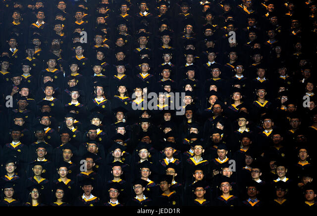 Xi'an, China's Shaanxi Province. 24th June, 2017. Graduates read the oath at the Commencement Ceremony of - Stock Image