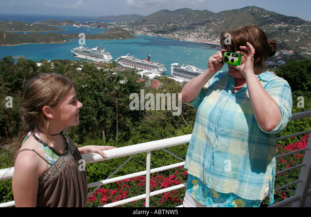 St. Thomas USVI Paradise Point girl poses for photo Charlotte Amalie Harbor Caribbean Sea cruise ships - Stock Image