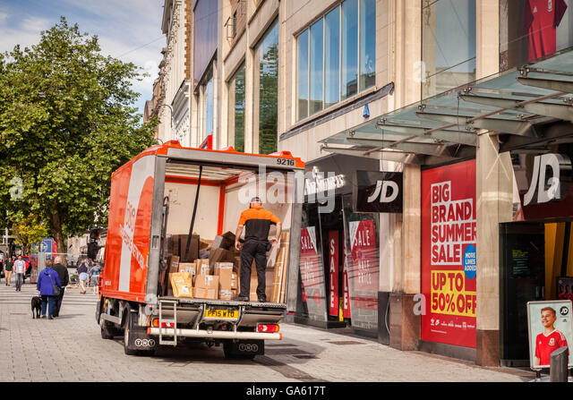 27 June 2016: Cardiff, Wales, UK - TNT delivery van in Cardiff city centre, Wales, UK - Stock Image
