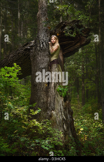 Blond girl in a magic forest - Stock Image