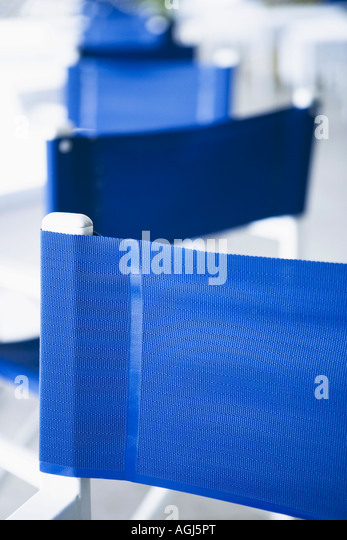 Close-up of an empty chair in a cafe - Stock Image
