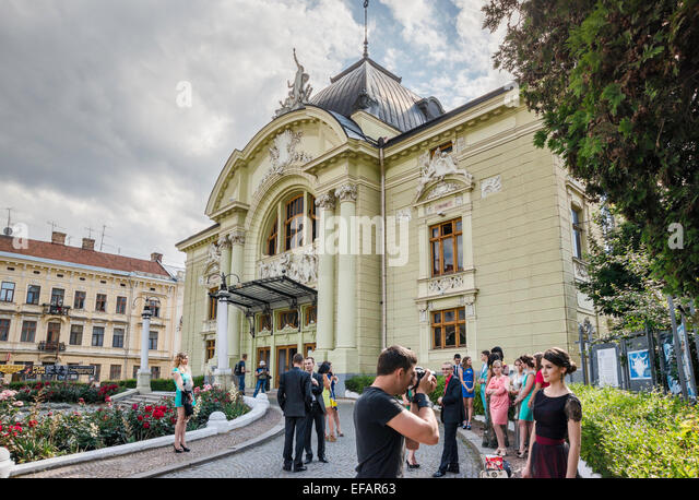 Young women and men at Olha Kobylianska Theatre of Music and Drama, 1905, Theatre Square in Chernivtsi, Bukovina - Stock Image