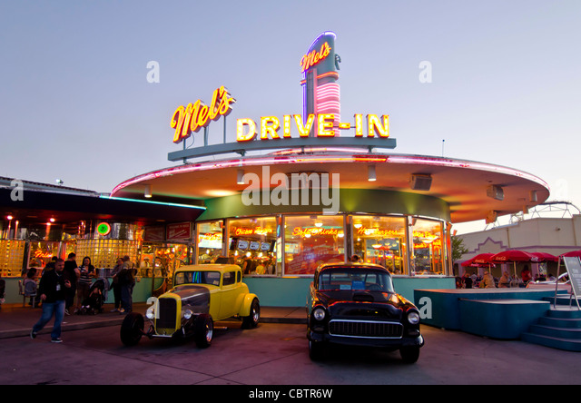 Mel's Drive-In restaurant with classic cars at twilight Universal Studios Orlando, Florida, - Stock Image