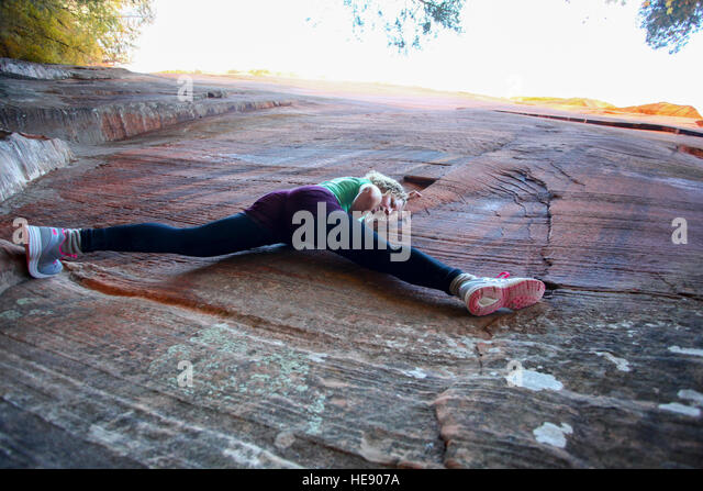 woman rock climbing at Zion National Park, Utah, USA - Stock Image