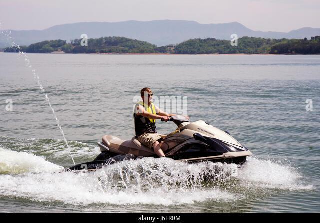 Tennessee Sevierville Douglas Lake jet ski wave runner teen boy water sport - Stock Image