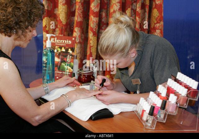 Puerto Rico Atlantic Ocean Holland America Line ms Noordam Greenhouse Salon manicure nail polish women - Stock Image