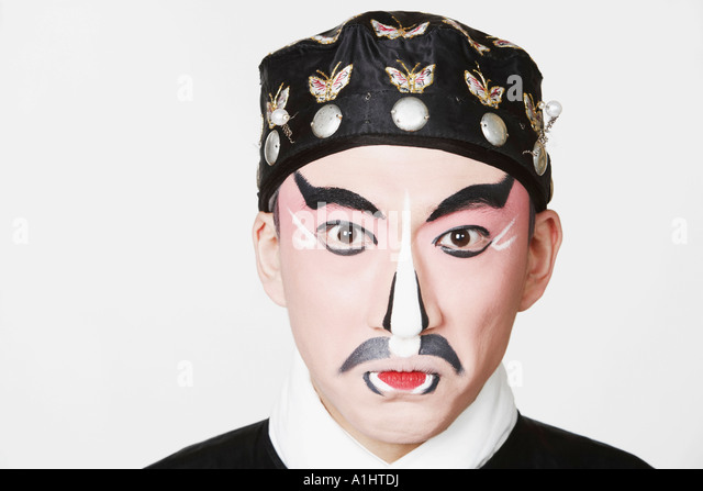 Portrait of a male Chinese opera performer making a face - Stock Image