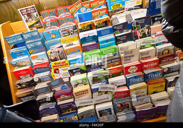 Colorful tourism leaflets for tourist attractions, Boston Tourist Information center, Boston, Massachusetts USA - Stock Image