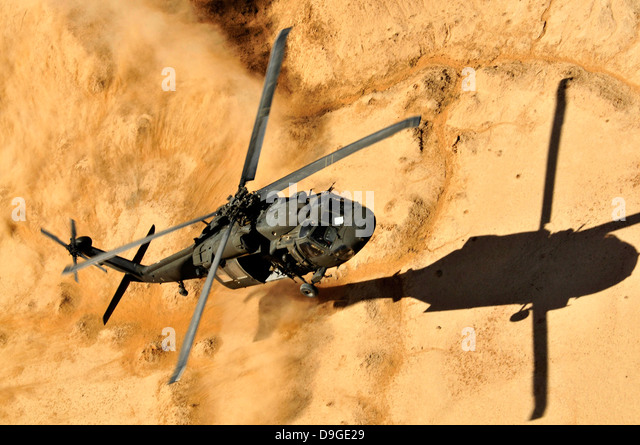 A UH-60 Black Hawk helicopter comes in for a dust landing. - Stock Image