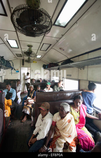 PASSENGERS ON TRAIN IN HILL COUNTRY NEAR HAPUTALE - Stock Image