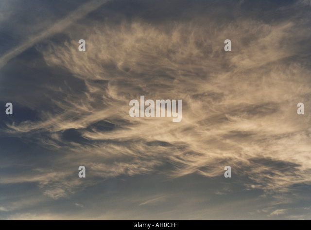 Cirrus clouds in a sunset sky - Stock Image