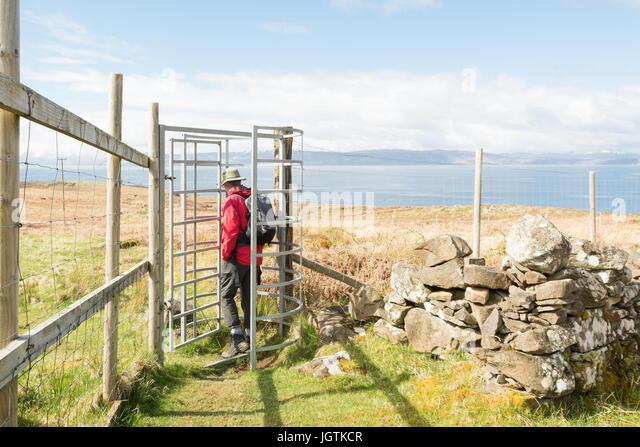 Deer proof metal gate and fencing - Applecross peninsula,  Wester Ross, Highland, Scotland, UK - Stock Image