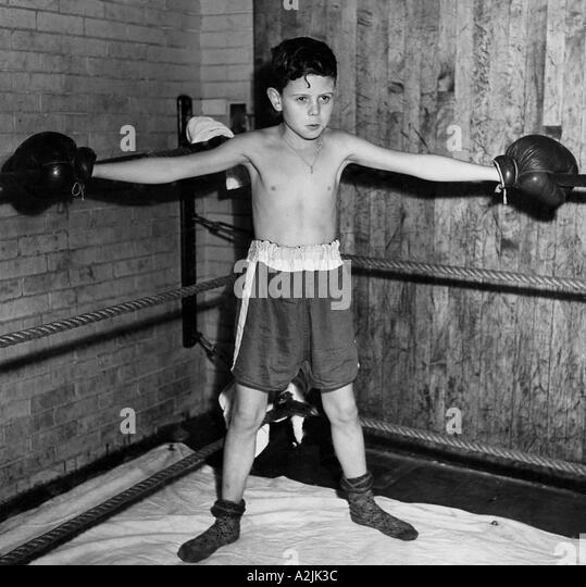 Determination shows on this young boy s face - Stock Image