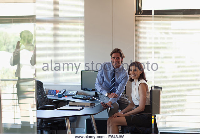 Business people with digital tablet working in office - Stock Image