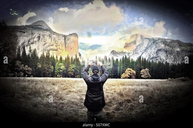 Man taking photo in Yosemite National Park, California - Stock Image