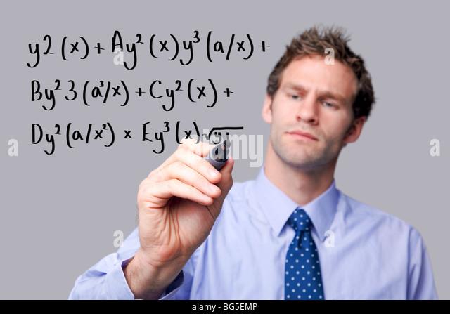 Teacher writing on a glass screen - Stock Image