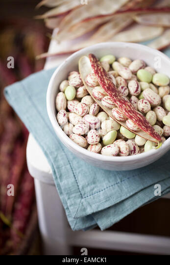 Borlotti Beans in White Bowl on Chair - Stock Image