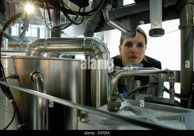 (dpa) - An employee of European Fuel Cell Gmbh, examines the beta field testing installation of a fuel cell for - Stock Image
