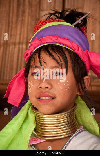 Karen hill tribe girl wearing traditional neck coil at Baan Tong Luang village of Hmong people in Chiang Mai Province - Stock-Bilder