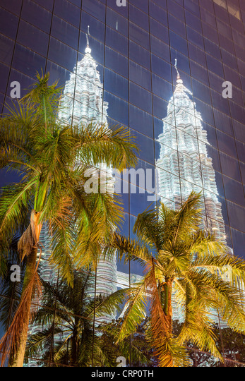 Low angle reflected view of the Petronas Twin Towers, Kuala Lumpur, Malaysia, Asia - Stock Image