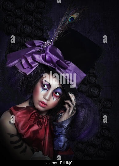 Expression. Pantomime. Clown in Fancy Carnival Hat with Artistic Makeup - Stock Image
