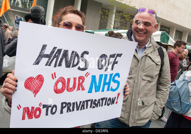 London, UK. 18th May 2013. London.  Two protesters with their placard demanding that the government leaves the NHS - Stock Image