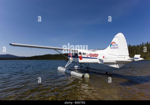 Taxiing, legendary de Havilland Canada DHC-2 Beaver, float plane, bush plane, Caribou Lakes, upper Liard River, - Stock Image
