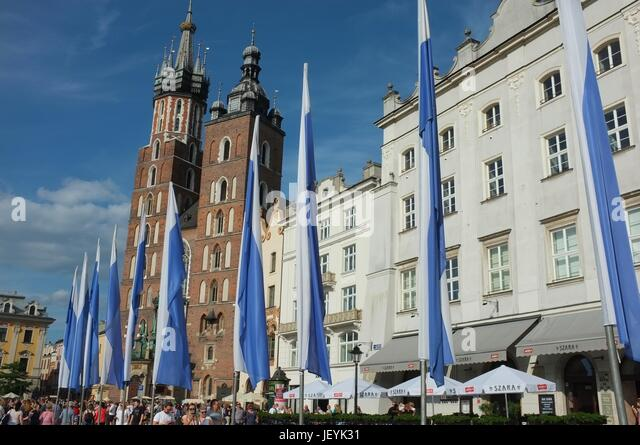 Flags in front of St Mary's Basilica, Main Market Square (Rynek Główny), Old Town, Krakow, Poland, Central/Eastern - Stock Image