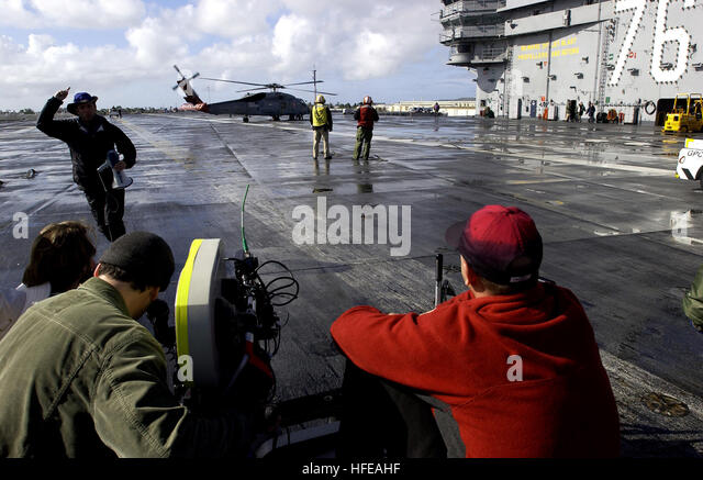 050304-N-8213G-039 San Diego, Calif. (Mar. 4, 2005) - A member of an NBC television crew shouts ÒRoll Camera, - Stock Image