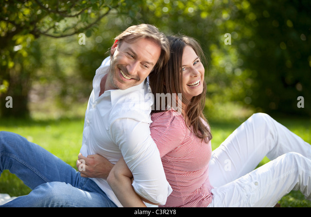 Germany, Bavaria, Couple having fun at picnic - Stock Image