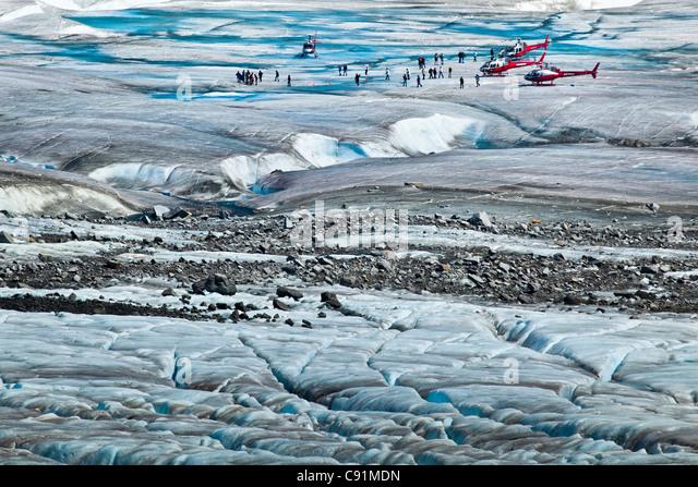 Helicopter tour passengers on Mendenhall Glacier, Juneau, Southeast Alaska, Summer - Stock Image