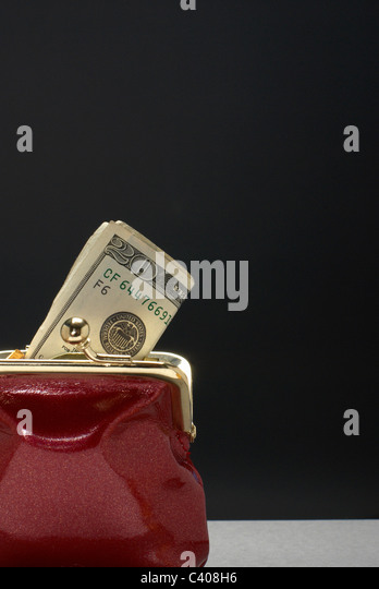 Purse with dollars in it - Stock Image