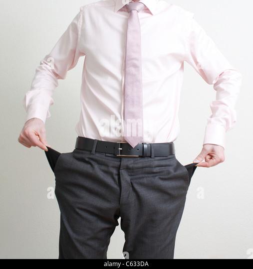 Emptying pockets - Stock Image