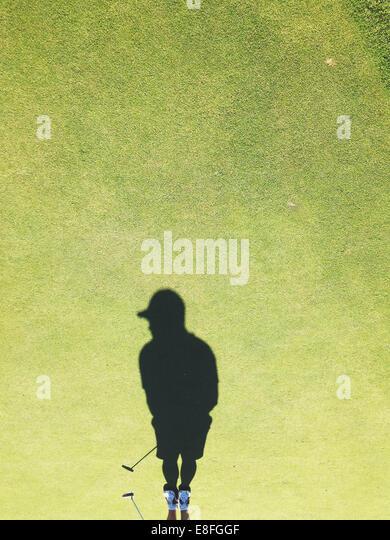 USA, Ohio, Montgomery County, Dayton, Shadow of golf player on golf course - Stock Image