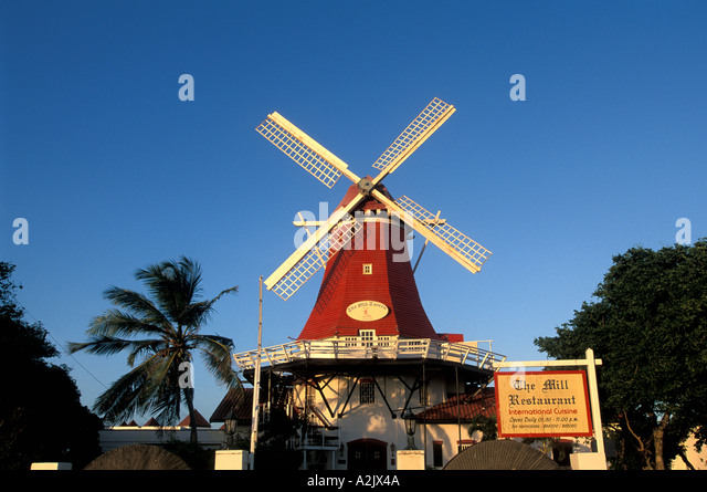 Aruba The Mill Restaurant Olde Molen bright red windmill with white blades iconic dutch image - Stock Image