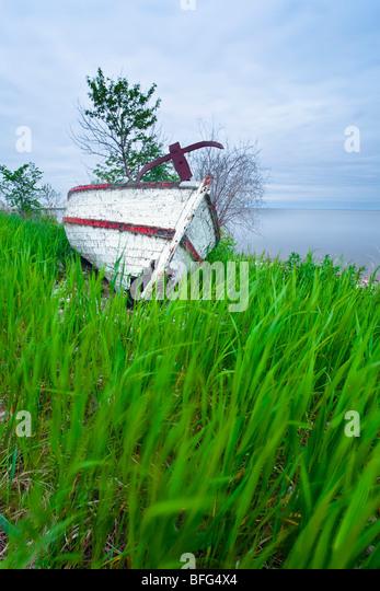 Abandonded boat wreck on Lake Winnipeg shoreline on Hecla Island.  Hecla Village on Island was an early Icelandic - Stock Image