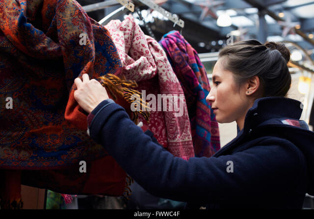 Young Woman Shopping In Covered Market - Stock Image