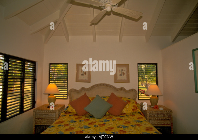 Caribbean island of Nevis, Nisbet Plantation Beach Club Hotel and Resort, guest room interior, tropical style decor - Stock Image