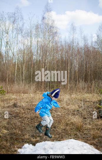 Sweden, Narke, Filipshyttan, Boy (8-9) playing in field - Stock Image