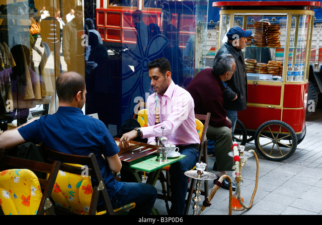 May 2008 - People sitting at a outdoors cafe near Istiklal street Istanbul Turkey - Stock Image