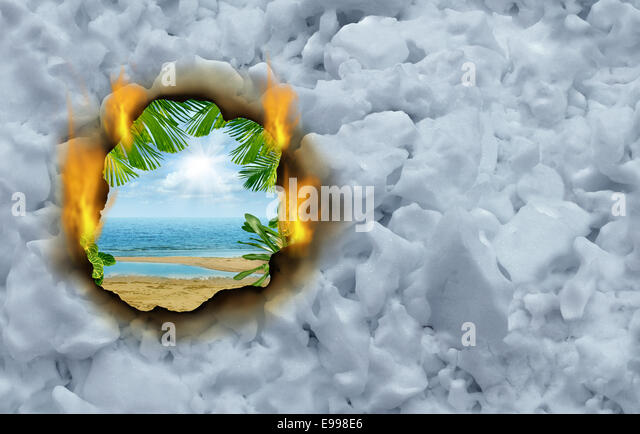 Winter escape concept as a burning hole on a cold winter snow background revealing a hot tropical beach and ocean - Stock-Bilder