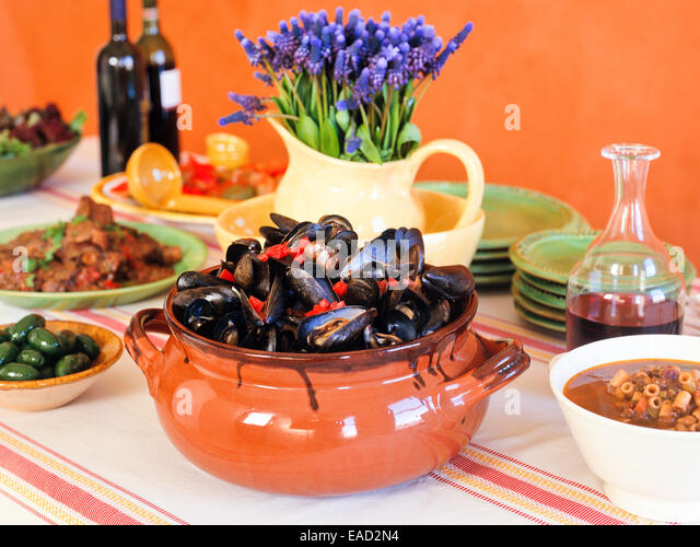 large Italian meal with various dishes - Stock Image
